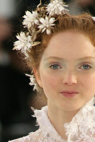 Lily Cole with a flower hairpiece