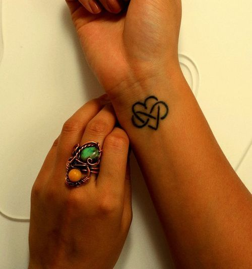 Polyamory Tattoo - A Heart Intertwined With An Infinity Symbol