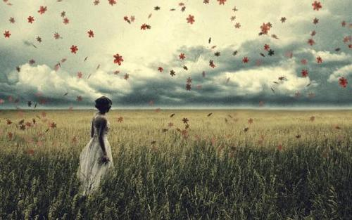 Sad-girl-in-a-grass-field-wallpaper_7860_large