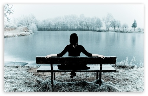 Woman_sitting_alone_on_a_bench-t2_large