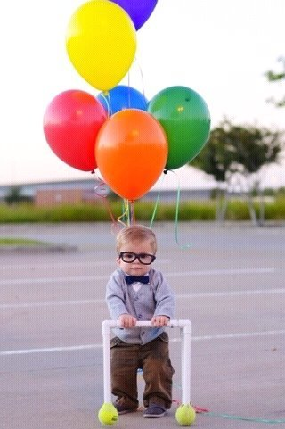 Kid with glasses and balloons.