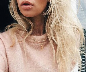 Image of blonde girl with pink sweater and moon necklace