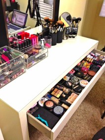 makeup table in a studio with expensive makeup and beauty products