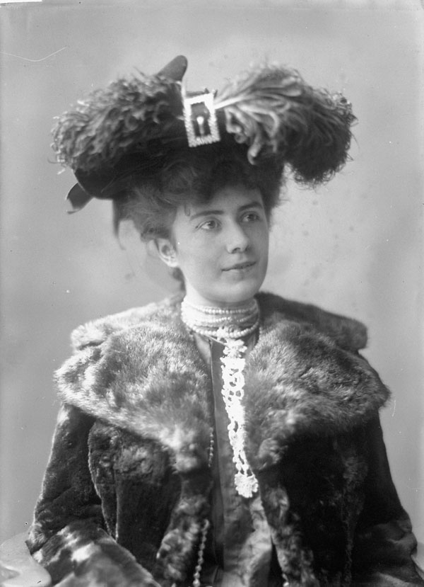 victorian woman in feather hat and fur collar coat 1902 canada
