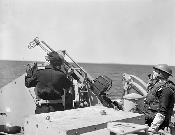 The crew of one of H.M.C.S. IROQUOIS' Oerlikon anti-aircraft guns at action stations during a training exercise off Halifax, Nova Scotia, Canada, 2 June 1944.