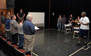 "The VGCC cast of ""Our Town"" rehearses a scene in which student Jordan Bunting, as Simon Stimson (far right), leads a church choir. (VGCC photo)"