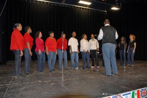 On stage at the 2013 Cultural Fair, VGCC instructor Steven Hargrove leads a choir of faculty, staff and students. (VGCC photo)