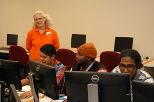 From left, VGCC Computer Education instructor Yolanda Yoder oversees students, including Alberto Ortiz of Henderson, B.K. Hall of Oxford, and Damian Maldonado of Henderson, in a computer lab on the college's Main Campus. (VGCC photo)