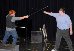 "From left, VGCC students Spencer Nunn of Warrenton (as ""Andrew Rally"") and Cody Trivette of Oxford (as ""John Barrymore"") rehearse a sword-fight scene for the play, ""I Hate Hamlet."" (VGCC photo)"