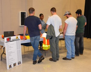 LaToya Caldwell of the N.C. Department of Transportation Office of Equal Opportunity & Workforce Services talks with attendees about careers and training opportunities at VGCC's first-ever Construction & Logistics Job Expo, held in April on the college's Main Campus. (VGCC photo)