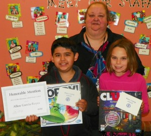 "From left, Allen Garcia-Reyes, a fifth grader, and Elizabeth Black, a third grader, both students at Aycock Elementary. Garcia-Reyes also holds the ""Honorable Mention"" award he received for his poster being recognized at the NCSBA Conference on November 16 in the grades 3-5 category. Pam Barrier, Aycock's art teacher who worked with the students, also is shown."