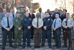 On front row, from left, VGCC Basic Law Enforcement Training Class 101 graduates Tony Joseph Tart, William Keegan Ruark, Travis Ty Womack, Wilbert Anthony Marrow, Brandon Jay Link, Thomas Henry Turner III, and Michael Wayne Martin; on back row, from left, VGCC instructor Glen Boyd, graduates Jason Tyler Wright, Jason Scott Penshorn, Jamison Patrick Vuolo, Elliott DeVar Carver, Tiquan Devard Terry and Patrick Ryan Fuqua, and VGCC law enforcement training coordinator Andrea Ferguson. (VGCC Photo)
