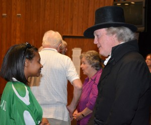 """VGCC student Latessa Wilkerson of Henderson talks with """"Thomas Jefferson"""" (Bill Barker) at the conclusion of his lecture at the college (VGCC photo)."""