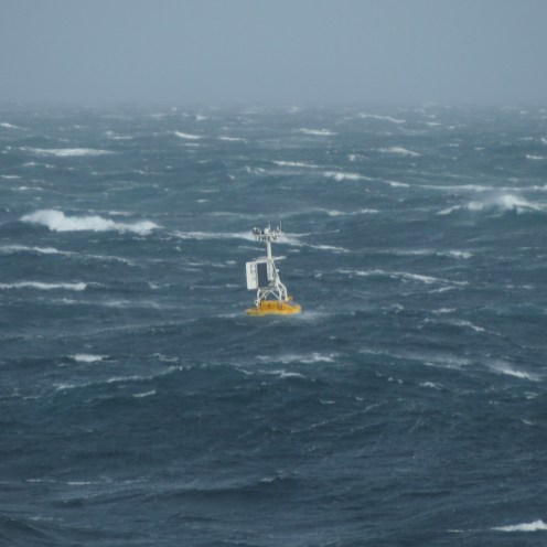 The Argentine Basin Surface Mooring buoy bobs with the waves after being deployed in over 3 miles of water (5.2km). Photo Credit: OOI Coastal Global Scale Nodes program Argentine Basin deployment team.