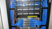 https://i0.wp.com/datatoronto.com/wp-content/uploads/2013/11/patch_panel_cable_wiring_installation2.jpg?resize=213%2C120