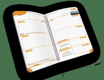 Open spiral-bound planner with days of week.