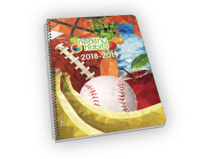 Spiral-bound planner with sports and vegetables cover.