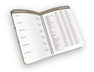 Open faced spiral-bound planner with days of week and holiday reference.