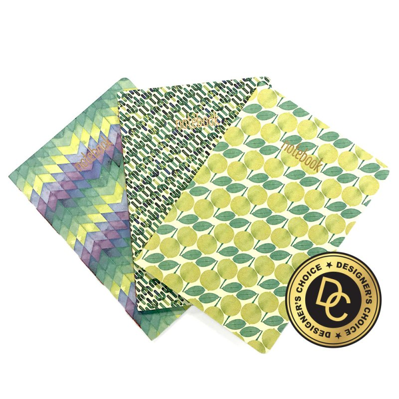 Group of small composition notebooks with various patterns.