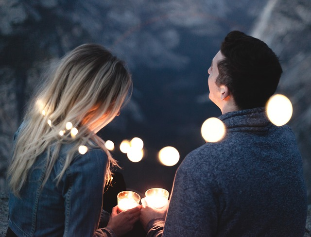 couple on date at night with candles - dating advice for men