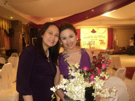Councilor Leah Librado, a 2012 BOD member, poses with JCI Duwaling's 2013 President Lani Abapo.