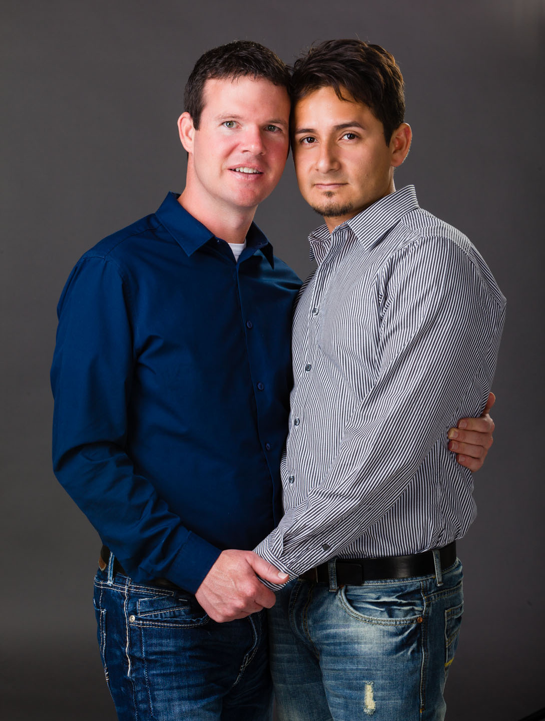 Couple portrait in studio with Alex and Jordan