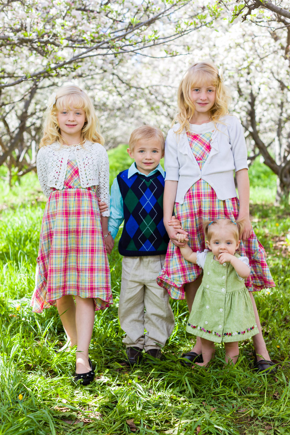 Bush children stand in the orchard