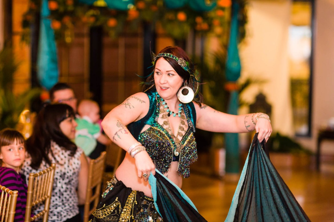 A belly dancer entertains the wedding guests