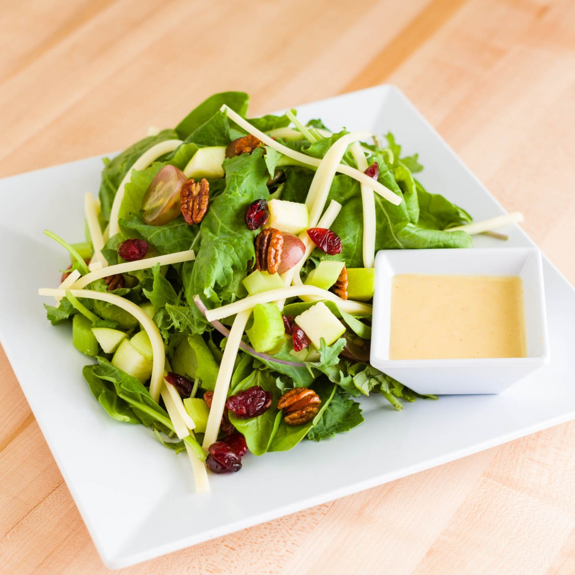 Spinach salad with kale, pecans, apples and cranberries