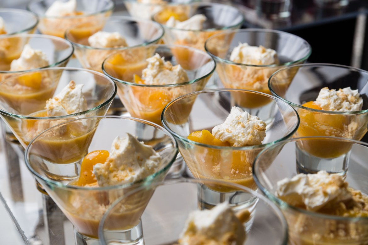 Peaches with mousse by Le Croissant Catering