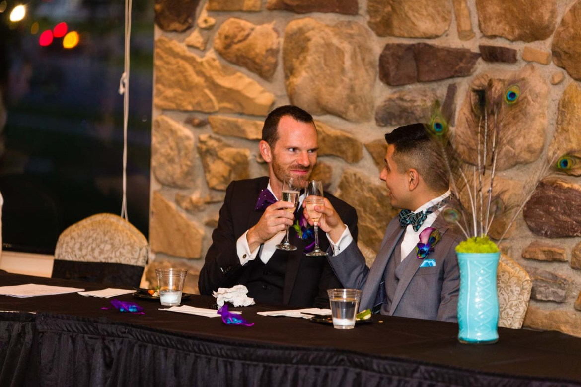 Grooms share a toast