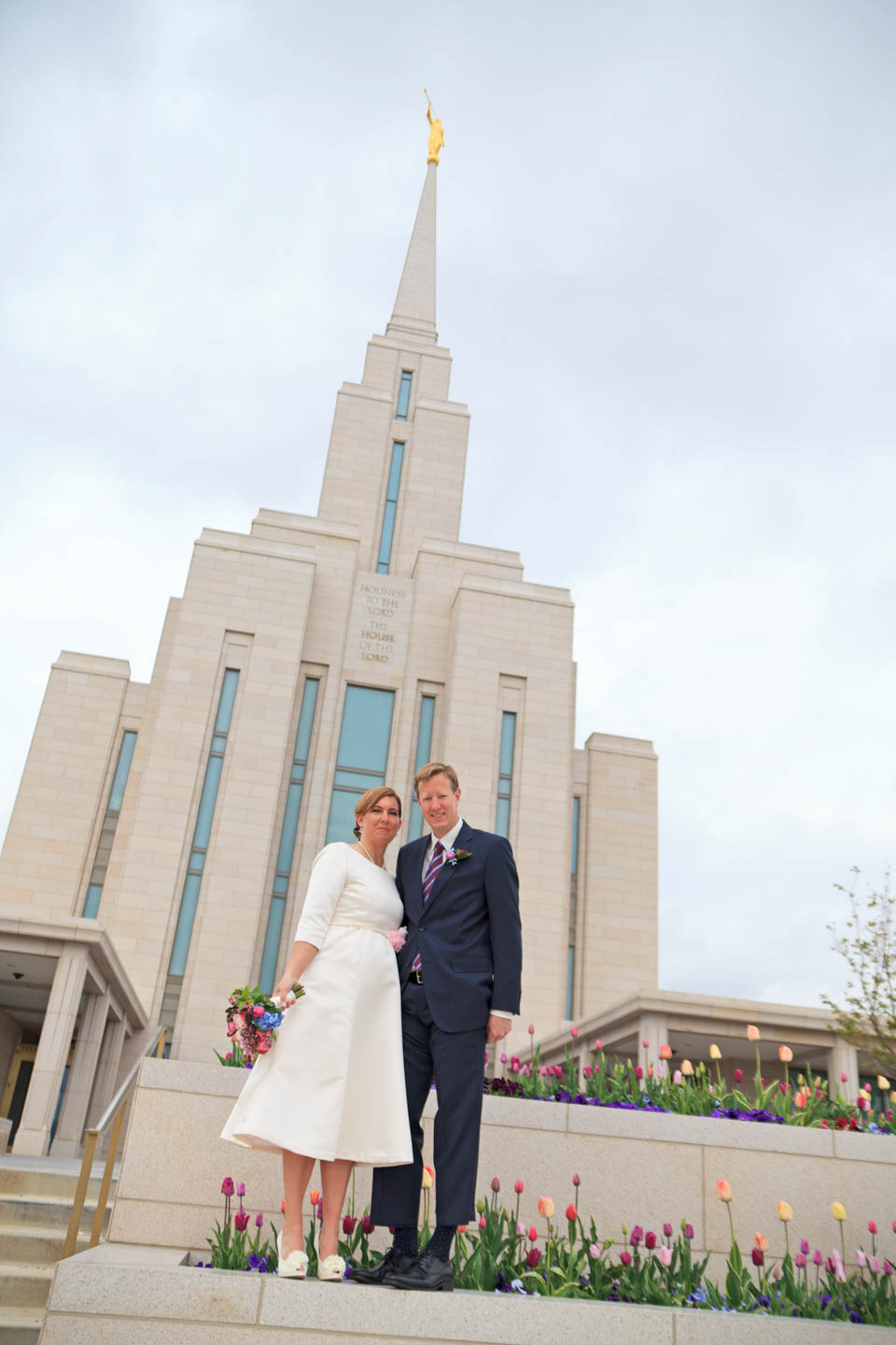 Bride and groom in front of the temple