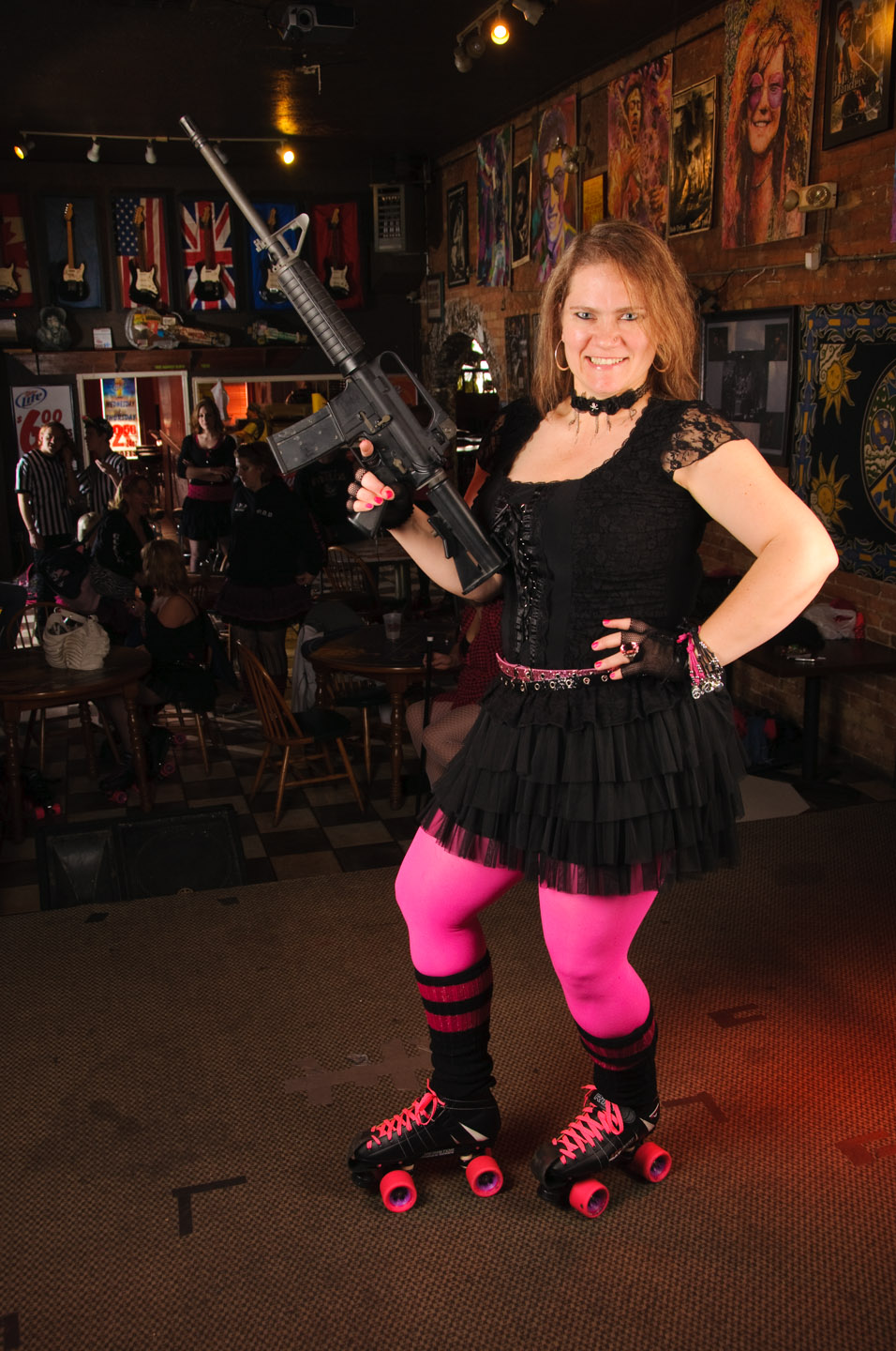 Someone brought a gun as a prop for her roller derby photo