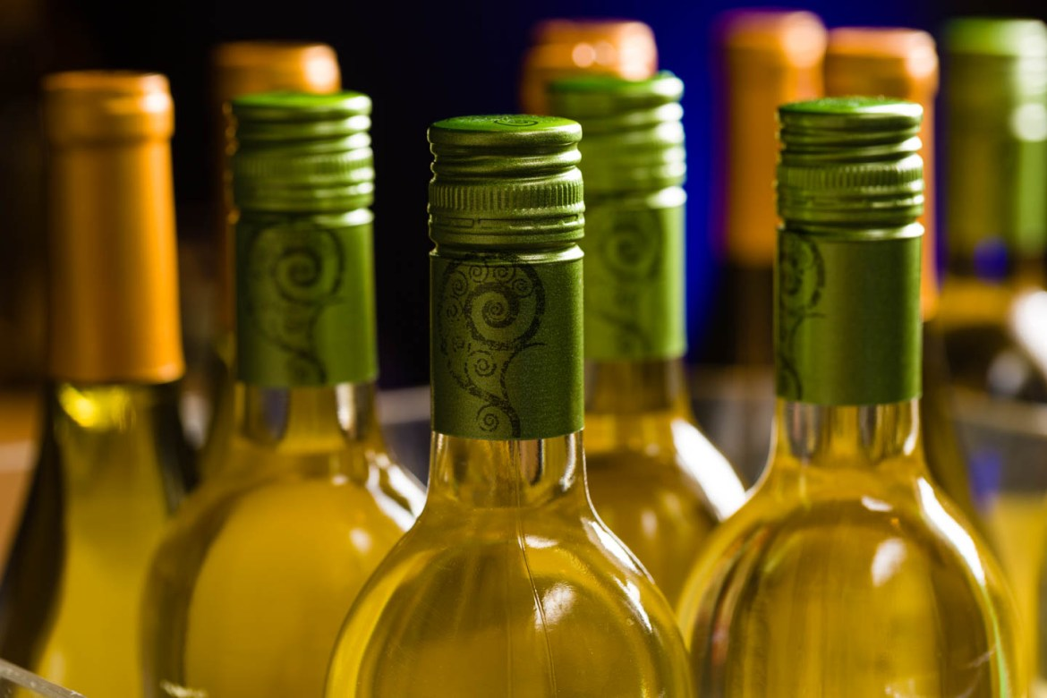 Wine bottles with white wine