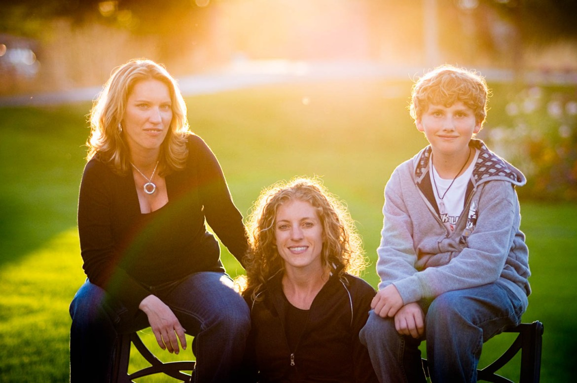 Family photograph with the sunlight behind the family