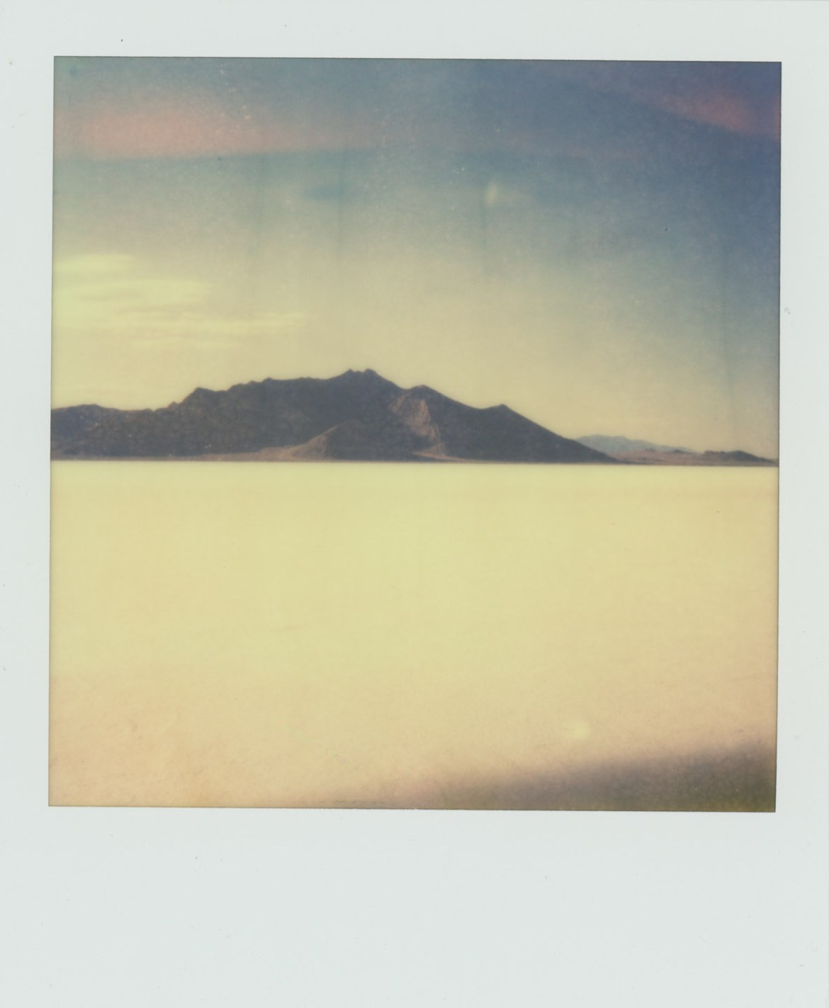 A sunny day on the Bonneville Salt Flats. Shot on instant film from Impossible Project