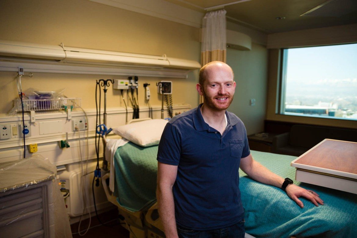 Brandon stands in one of the hospital rooms at the Huntsman Cancer Institute