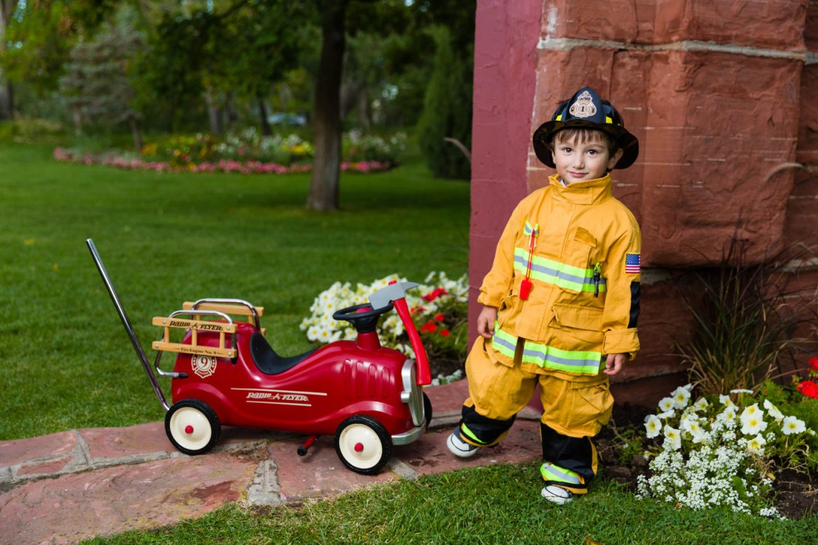 Alexander is dressed as a fire fighter