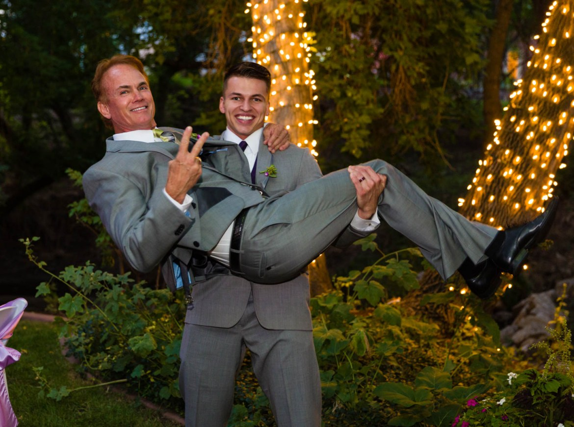 Groom holds the father of the bride