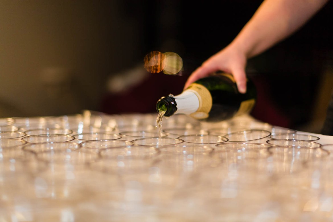 Pouring champagne for the wedding toast