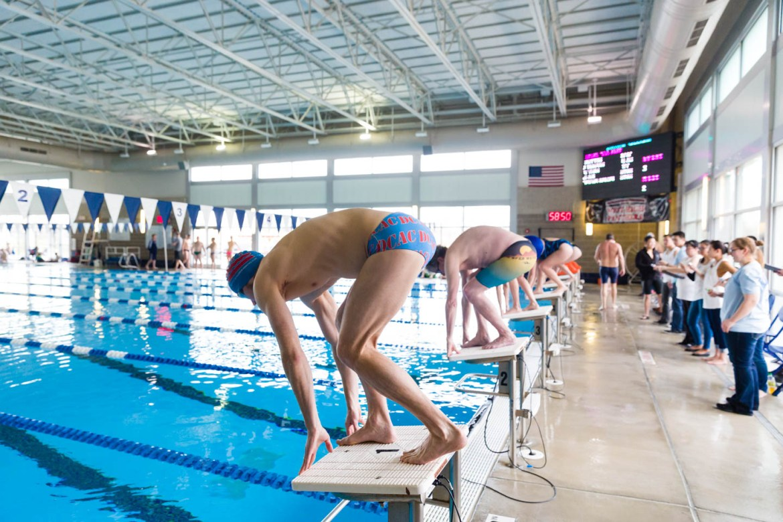 Swimmers start the race on blocks
