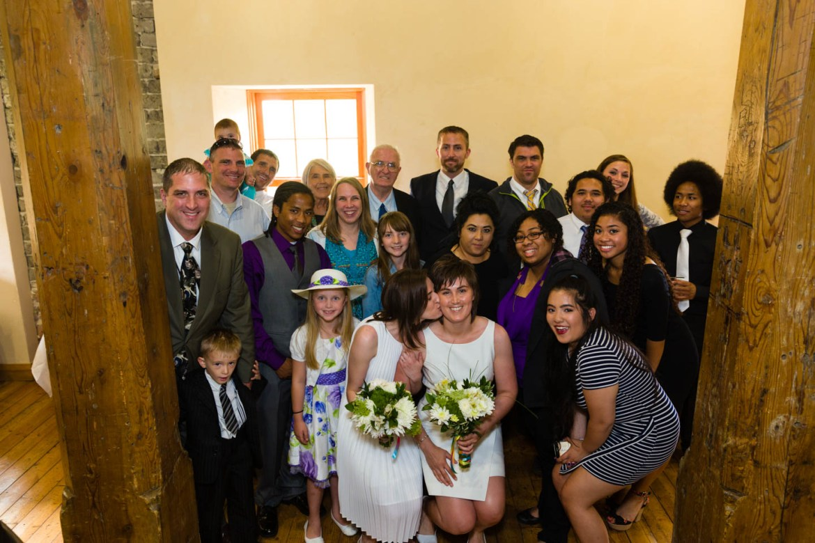 The brides pose with Ronda's family