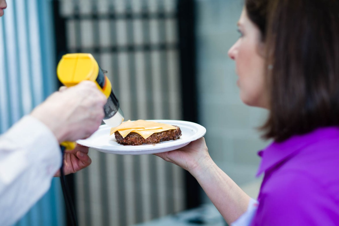 A heat gun from Home Depot is used to melt cheese