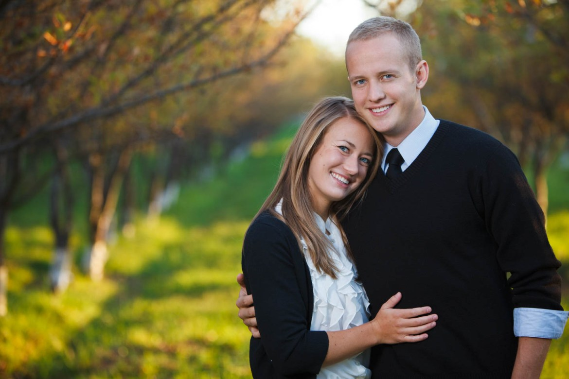 Engagements in an apple orchard in autumn
