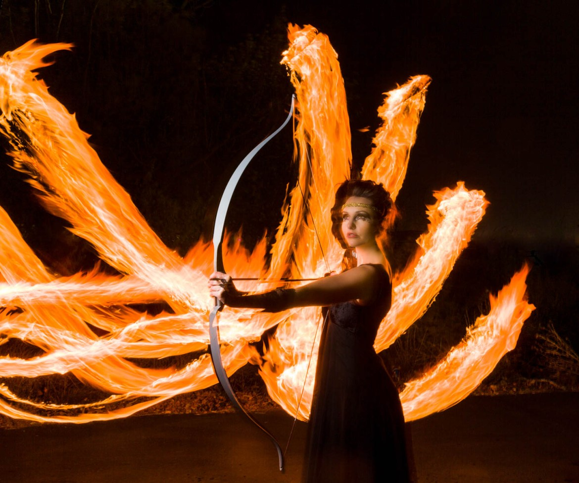 Girl on Fire... female model with fire in the background