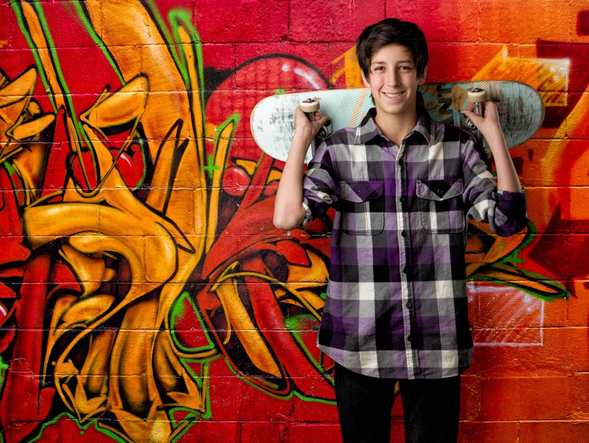 Photoshopped a skateboarder in front of a graffiti wall