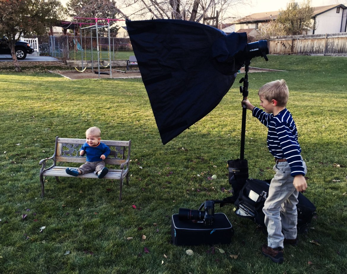 Behind the scenes photo with Henry holding the Profoto B1 steady