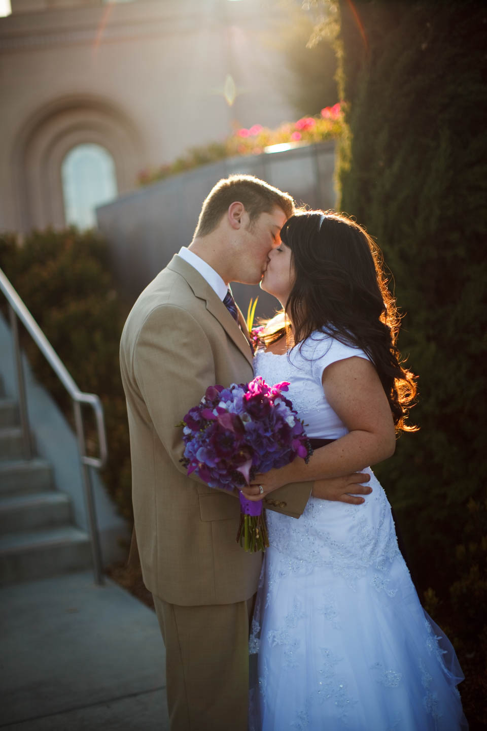 Bride and groom kiss after the portrait session