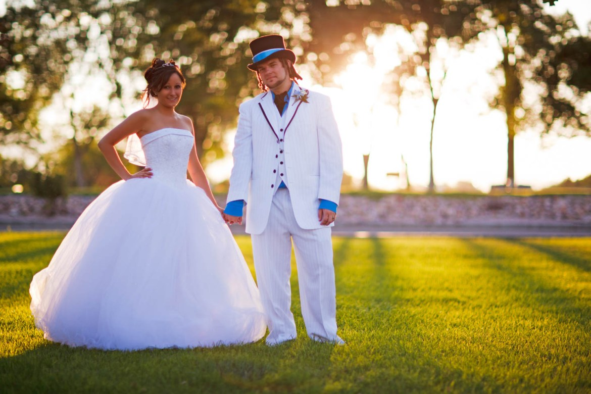 Formal bride and groom portraits with backlight