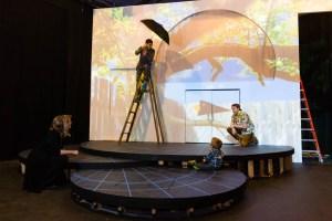 Actors practice in dress rehearsal